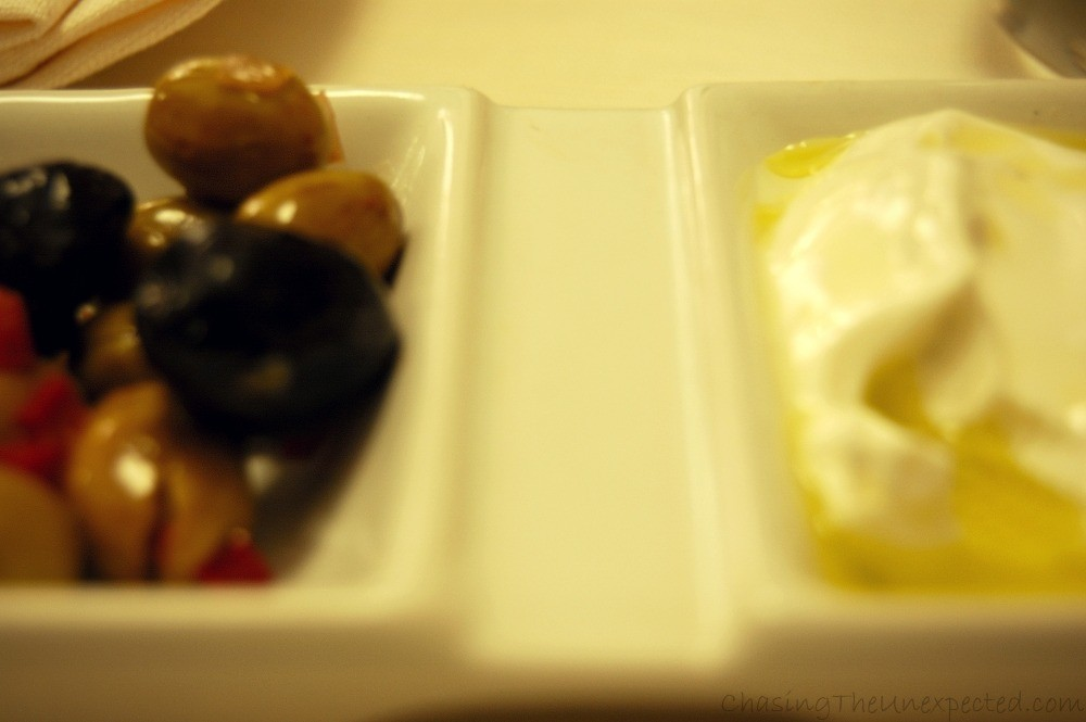 Sour yogurt and seasoned olives to eat with pita bread as a starter.