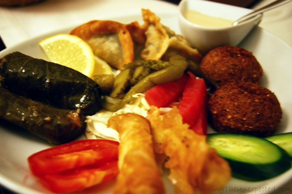 Falafel, rice wrapped in vine leaves, fried cheese and veggies part of the Vegetarian Mezzeh.