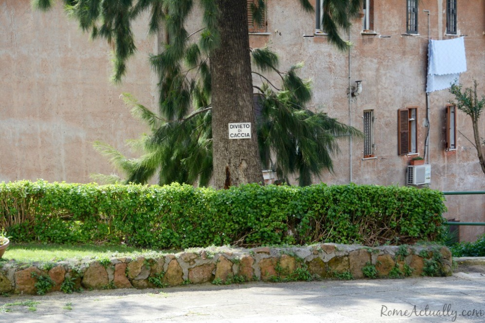 """The humor, never missing among Romans. Here a warning sign """"No hunting"""" (inside the city?)"""