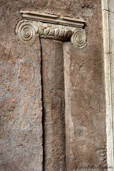 Ancient Roman pillar embedded in a more recent palace